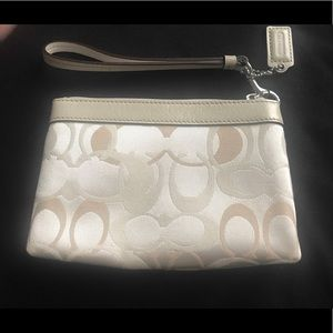 """Brand New Coach Ivory Wristlet (approx 4"""" by 7"""")💗"""